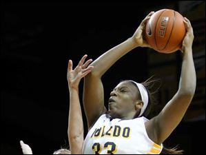 University of Toledo player Yolanda Richardson (33) grabs a rebound against Ohio's Erin Bailes (3).