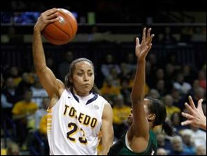 Toledo player Inma Zanoguera (23) passes over Ohio University player Symone Lyles (15).