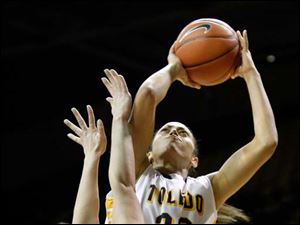 Toledo's Inma Zanoguera (23) is fouled by Ohio University's Tina Fisher (21).