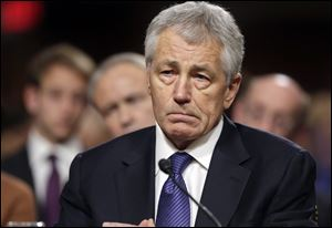 Republican Chuck Hagel, President Obama's choice for defense secretary, testifies before the Senate Armed Services Committee during his confirmation hearing, on Capitol Hill in Washington, Thursday.