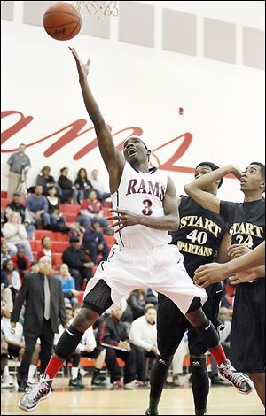 Rogers senior Tony Kynard, who finished with 24 points, goes to the net against  Start's Michael Mitchell.