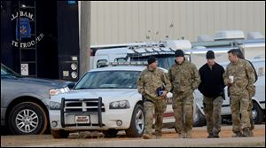 Law enforcement officials continue to work the scene of the hostage crisis in Midland City, Ala., Friday, Feb. 1, 2013.