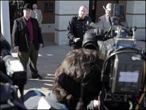 From left, Kaufman District Attorney Mike McLelland, Kaufman Police Chief Chris Aulbaugh, Kaufman County Sheriff David Byrnes update the media on the shooting death of assistant district attorney Mark Hasse,at the Kaufman County Law Enforcement Center Friday Feb. 1, 2013.