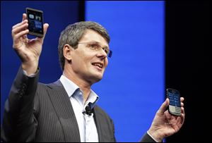 Thorsten Heins, CEO of BlackBerry, holds the company's new smartphones -- touchscreen Z10, left, and, for BlackBerry keyboard loyalists, the Q10.
