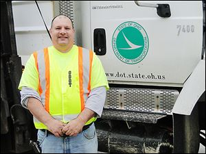 George Seambos, an Ohio Department of Transportation employee, blocked northbound U.S. 23 at the Michigan border Jan. 26, forcing a wrong-way driver into the proper lanes.