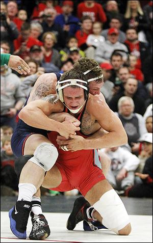 OSU's Cody Magrum, an Oak Harbor alumnus, fails to escape from Illinois' Tony Dallago late in their 184-pound match.