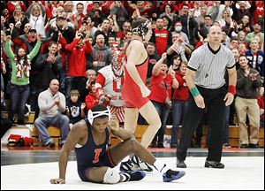 Ohio State fans celebrate with Logan Stieber after he pins Illinois' Daryl Thomas during their 133-pound match at Oak Harbor High School. Stieber had missed the last five duals with an injury.