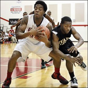 Rogers' Tribune Dailey, Jr., keeps a rebound away from Start's David Cox in the Rams' victory. Dailey scored 12 points.