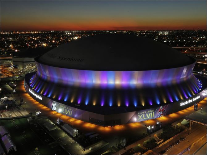 The Superdome, where the NFL Super Bowl XLVII football game between the San Francisco 49ers and Baltimore Ravens will be played, is seen at sunset today in New Orleans.