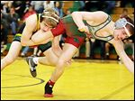Clay's Richie Screptock, left, won a 6-1 de­ci­sion against Cen­tral Catholic soph­o­more Josh Moss­ing. Screp­tock won the TRAC's 113-pound ti­tle a year ago, also beat­ing Moss­ing in that fi­nal.