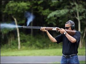 President Obama shoots clay targets on the range at Camp David, Md., last August.