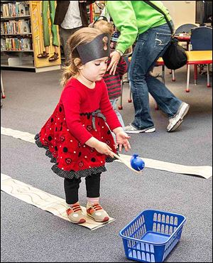 Sophia Witham - Age 2 - daughter of Dan and Lori Witham - playing walk the plank.
