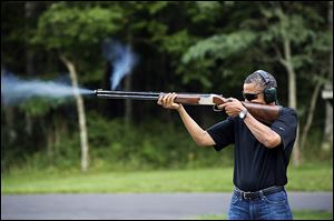 President Obama shoots clay targets on the range at Camp David, Md., last August. He has proposed changes in gun control.