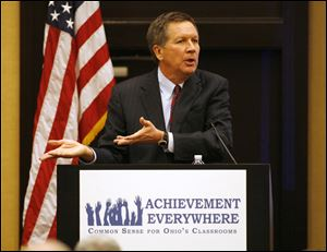Gov. John Kasich speaks at a special meeting of the Buckeye Association of School Administrators last week about his school funding reform plan. His two-year budget proposal, to be unveiled Monday, is expected to offer an income tax cut.