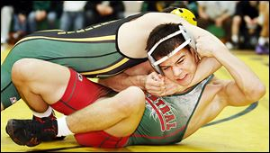 Central Catholic's Nate Hagan, right, works free from Clay's Brian Henneman in the 126-pound final. Hagan won 9-4.