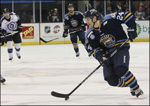 Forward Bryon Froese pushes the puck toward the goal earlier this season for the Toledo Walleye.