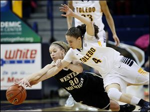 Toledo's Naama Shafir battles for a loose ball with Western Michigan's Alex Morton.