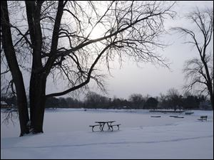 Snow covers Olander Park in Sylvania, Sunday morning.