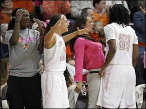 BG players, from left, Jasmine Matthews, Jillian Halfhill, Simone Eli, and Alexis Rogers celebrate a 3-point shot.