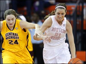 The Falcons' Chrissy Steffen, right, leads the fast break against Central Michigan's Niki DiGulio.