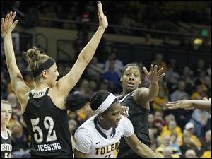 Toledo's Lecretia Smith loses the ball as Western Michigan's Jessica Jessing  defends.