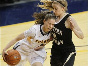 Toledo's Naama Shafir is fouled by Western Michigan's Alex Morton.
