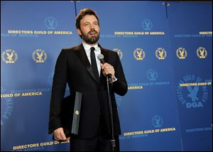 "Ben Affleck speaks holds his award for outstanding directorial achievement in feature film for ""Argo"" at the 65th Annual Directors Guild of America Awards in Los Angeles."