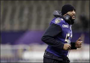 Baltimore Ravens linebacker Ray Lewis jogs during an NFL Super Bowl XLVII walkthrough on Saturday in the Mercedes-Benz Superdome in New Orleans.