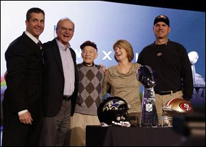 The Harbaugh family, including, from left, Ravens coach John, father Jack, grandfather Joe Cipiti, mother Jackie, and 49ers coach Jim, gathers during Super Bowl week in New Orleans.