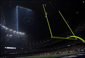 Half the lights are out in the Superdome during a power outage with 13 minutes, 22 seconds left in the third quarter of Super Bowl XLVII on Sunday in New Orleans.