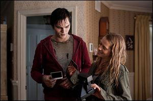 Nicholas Hoult, left, and Teresa Palmer in a scene from