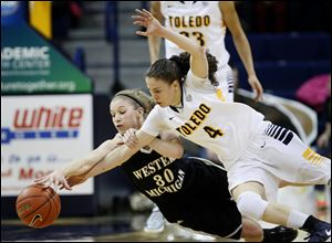 UT's Naama Shafir, right, who had 14 points and nine assists, battles Western Michigan's Alex Morton.