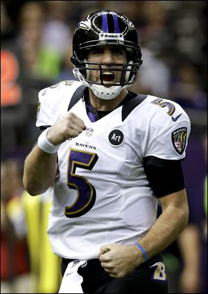 Baltimore Ravens quarterback Joe Flacco celebrates on of his three first-half touchdowns.