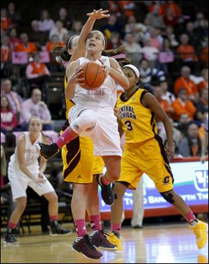 BG's Jillian Halfhill, who had 14 points, is fouled by Central Michigan's Jessica Schroll. The Falcons are 14-7, 5-3 in the MAC.