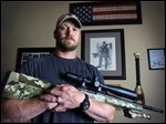 Former Navy SEAL and author of the book 'American Sniper,' Chris Kyle poses in Midlothian, Texas, in 2012. He was found dead at a shooting range on Saturday.
