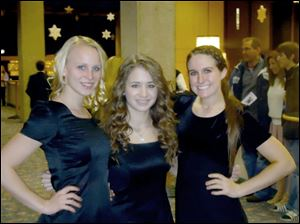 From left to right: Angel Overholt, Allie Stuckey and Raegen Vickers, all Perrysburg High School students, participated in OMEA District I Honors Choir at the Stranahan Theater, Jan. 20.