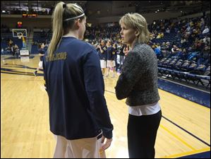 University of Toledo women's associate head basketball coach Vicki Hall speaks with player Kyle Baumgartner.