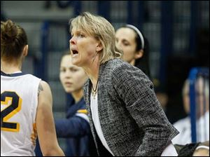 University of Toledo women's associate head basketball coach Vicki Hall gives some instructions to her players.