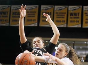 Toledo's Naama Shafir grabs a rebound in front of Western Michigan's Marquisha Harris.