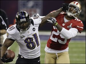 Baltimore Ravens wide receiver Anquan Boldin stiff-arms San Francisco 49ers cornerback Chris Culliver during the Super Bowl. Boldin had 104 receiving yards and a touchdown.