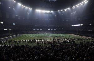 Half the lights went out in the Superdome during a 34-minute power outage in the second half of the Super Bowl on Sunday.