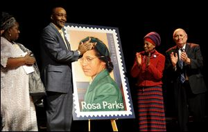 Councilwoman Joann Watson, from left, Lloyd Wesley, Jr., Detroit postmaster,  Elaine Eason Steele, co-founder of the Rosa and Raymond Parks Institute for Self Development, and Sen. Carl Levin applaud at the unveiling of the Rosa Parks' 100th birthday commemorative postage stamp at the Museum of African American History in Detroit today.