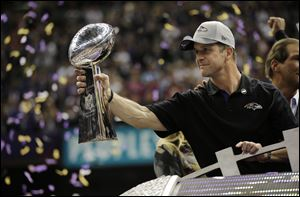 Baltimore Ravens coach John Harbaugh holds the Vince Lombardi Trophy as he celebrates his team's 34-31 win against the San Francisco 49ers in Super Bowl XLVII on Sunday in New Orleans.
