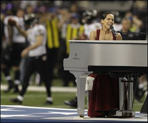 Alicia Keys sings the national anthem before the Super Bowl.