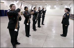 Cadet Major Ashley Balla, right, leads Junior ROTC drill team members, from left, Christina Yeakle, Mariah Coleman, Mackenzie Shiple, Issa Amad, and Devonte Fountain, in a drill at Springfield High School in Holland.  The team has been chosen to participate in a national competition in Louisville.
