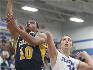 Whitmer's Ricardo Smith (10) goes to the net against  Anthony Wayne's Mark Donnal (34).