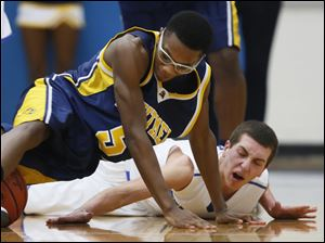 Anthony Wayne's Matt Fox (3) and Whitmer's Chris Parker (5) chase a loose ball.