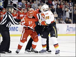 Detroit's Jordin Tootoo (22) battles Calgary Flames center Steve Begin in a fight during the first period.
