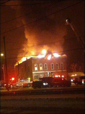 Three people died in a fire that engulfed the Old Antique Store in Harpster, Ohio, early today.