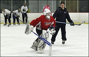 St. John's coach Mike Hayes watches goaltender Mike Barrett skate at practice. Barrett has a 1.67 goals-against average and a .929 save percentage.